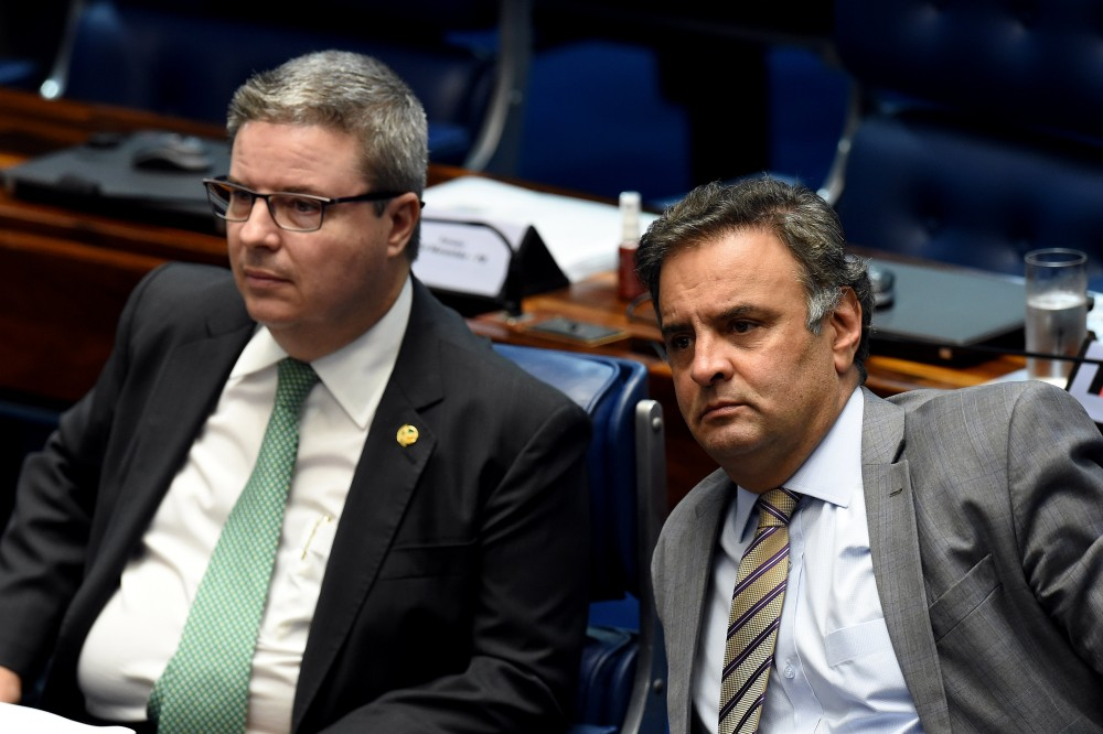 """Senator Aecio Neves (R), who heads the PSDB opposition party, sits next to senator Antonio Anastasia, also from the PSDB, during a senate's session to form a committee that will consider whether to impeach President Dilma Rousseff, in Brasilia, on April 25, 2016.<br /><br /><br /><br /><br /><br /><br /><br /> Brazil's Senate met Monday to form a committee that will consider whether to impeach Rousseff, who has accused her opponents of mounting a constitutional coup. She is accused of illegal government accounting maneuvers, but says she has not committed an impeachment-worthy crime. The Senate committee — comprising 21 of the 81 senators — was to debate Rousseff's fate for up to 10 working days before making a recommendation to the full upper house.<br /><br /><br /><br /><br /><br /><br /><br />  / AFP / EVARISTO SA        (Photo credit should read EVARISTO SA/AFP/Getty Images)"""" /></a></p> <p class="""