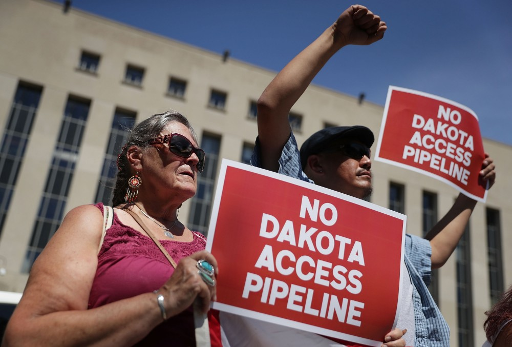 "WASHINGTON, DC - AUGUST 24:  Members of the Red Lake Nation participate during a rally on Dakota Access Pipeline August 24, 2016 outside U.S. District Court in Washington, DC. Activists held a rally in support of a lawsuit against the Army Corps of Engineers ""to protect water and land from the Dakota Access Pipeline,"" and to call for ""a full halt to all construction activities and repeal of all pipeline permits until formal tribal consultation and environmental review are conducted.""  (Photo by Alex Wong/Getty Images)"