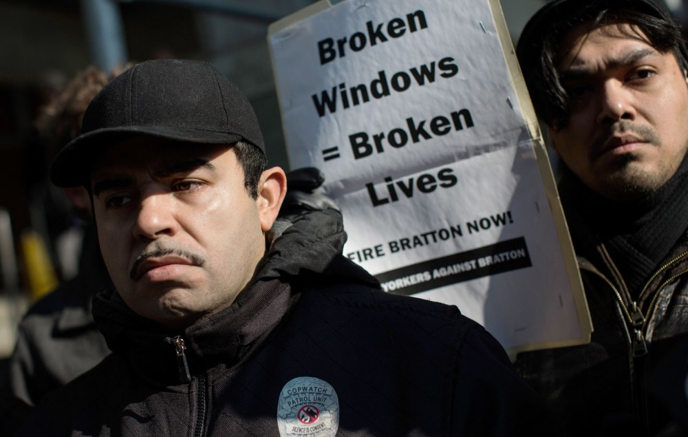 """NEW YORK, NY - JANUARY 16:  Activists protest the New York Police Department's """"Broken Windows"""" policy outside the Patrolmen's Benevolent Association offices on January 16, 2015 in New York City. The protest comes at a time when police and community relations are strained after the death of Eric Garner, a black man who was killed by a police officer using a choke hold in July, 2014.  (Photo by Andrew Burton/Getty Images)"""