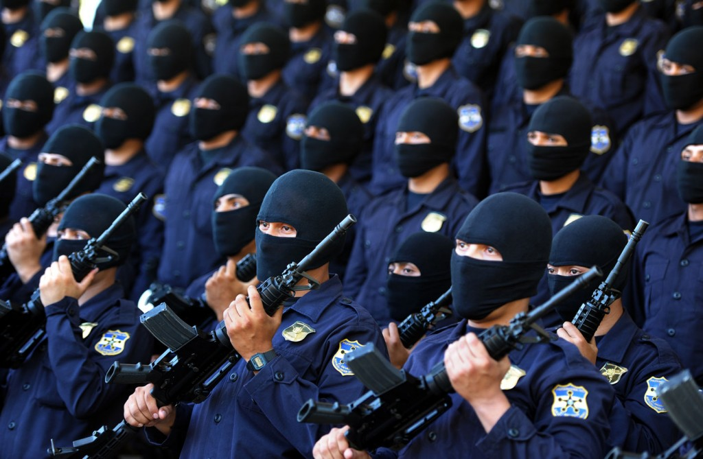 Salvadorean policemen from a new anti-gang task force parade in Comalapa, 38 km south of San Salvador,  January 9, 2012.  AFP PHOTO/ Jose CABEZAS (Photo credit should read Jose CABEZAS/AFP/Getty Images)
