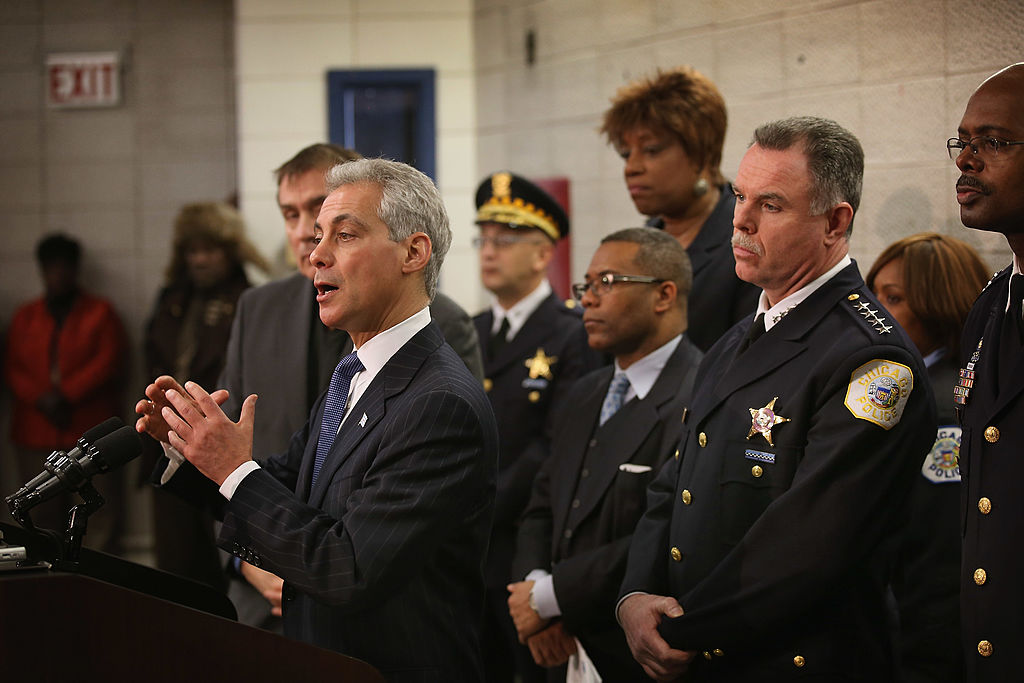 CHICAGO, IL - JANUARY 31:  Chicago Police Superintendant Garry McCarthy (2nd from right) listens as Mayor Rahm Emanuel discusses a plan to reassign 200 police officers from administrative duties back to patrol duties during a press conference on January 31, 2013 in Chicago, Illinois. Chicago has been faced with a rising murder rate largely attributed to an increase in gang related violence. Last year the city had more than 500 murders. The city has had more than 40 murders in January 2013, surpassing the total for January 2012.  (Photo by Scott Olson/Getty Images)