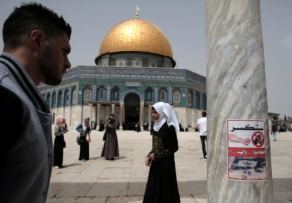 """A poster, calling for the destruction of CCTV cameras, is seen on a column at the Al-Aqsa Mosque compound in Jerusalem, in front of the Dome of the Rock on April 8, 2016.Jordan, who administrate the site, said it will set up security cameras around Jerusalem's flashpoint Al-Aqsa mosque compound in the coming days to monitor any Israeli """"violations."""" / AFP / AHMAD GHARABLI (Photo credit should read AHMAD GHARABLI/AFP/Getty Images)"""