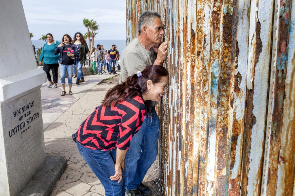 TIJUANA, MX. - APRIL 9 2016:  Leticia Orozco and Manuel Aguirre peer through the border at their children and grand children in Friendship Park in Tijuana. </p><br /><br /><br /><br /><br /> <p>Natalie Keyssar