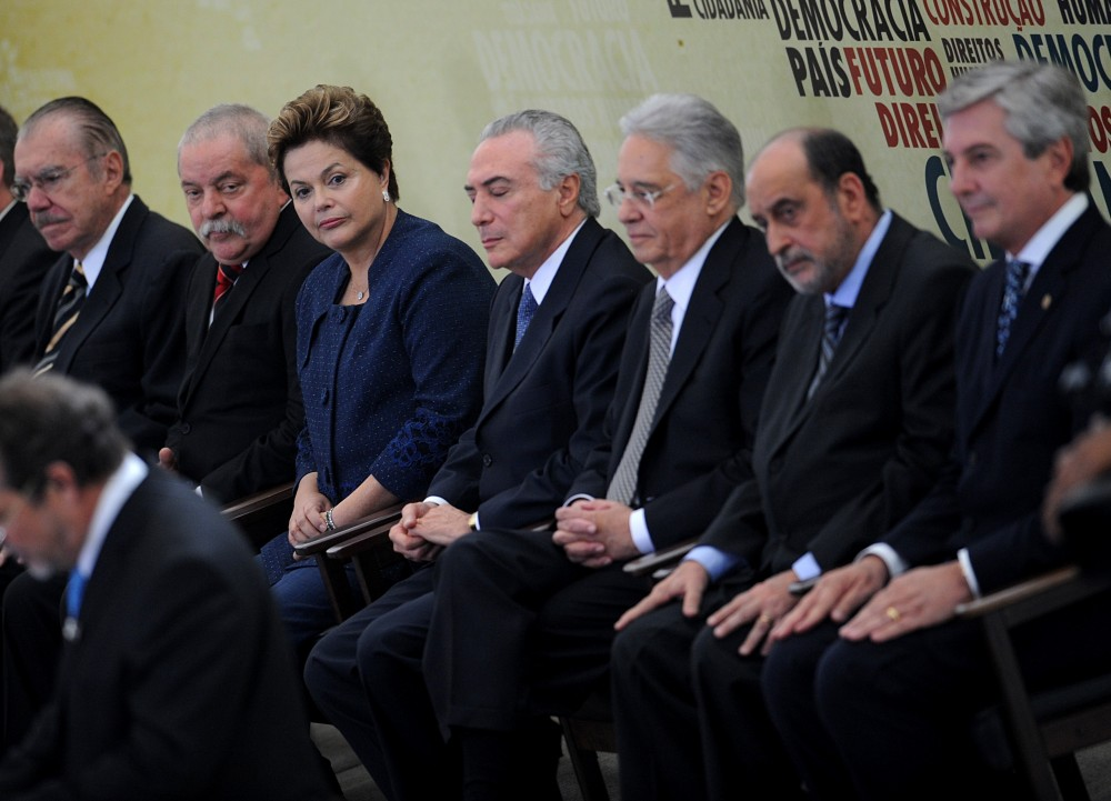 Brazilian President Dilma Rousseff (3-L) takes her seat during the inauguration ceremony of the National Commission of Truth that will investigate crimes and human rights violations committed during the Brazilian military dictatorship (1964-1984), at Planalto Palace, in Brasilia, on May 16, 2012. Also attending the ceremony Brazilian former presidents Jose Sarney (L), Luiz Inacio Lula da Silva (2-L), Fernando Henrique Cardoso (3-R) and Fernando Collor (R), and Vice-President Michel Temer (C) and the coordinator of the Commission Gilson Dipp (2-R).  AFP PHOTO/Pedro LADEIRA        (Photo credit should read PEDRO LADEIRA/AFP/GettyImages)