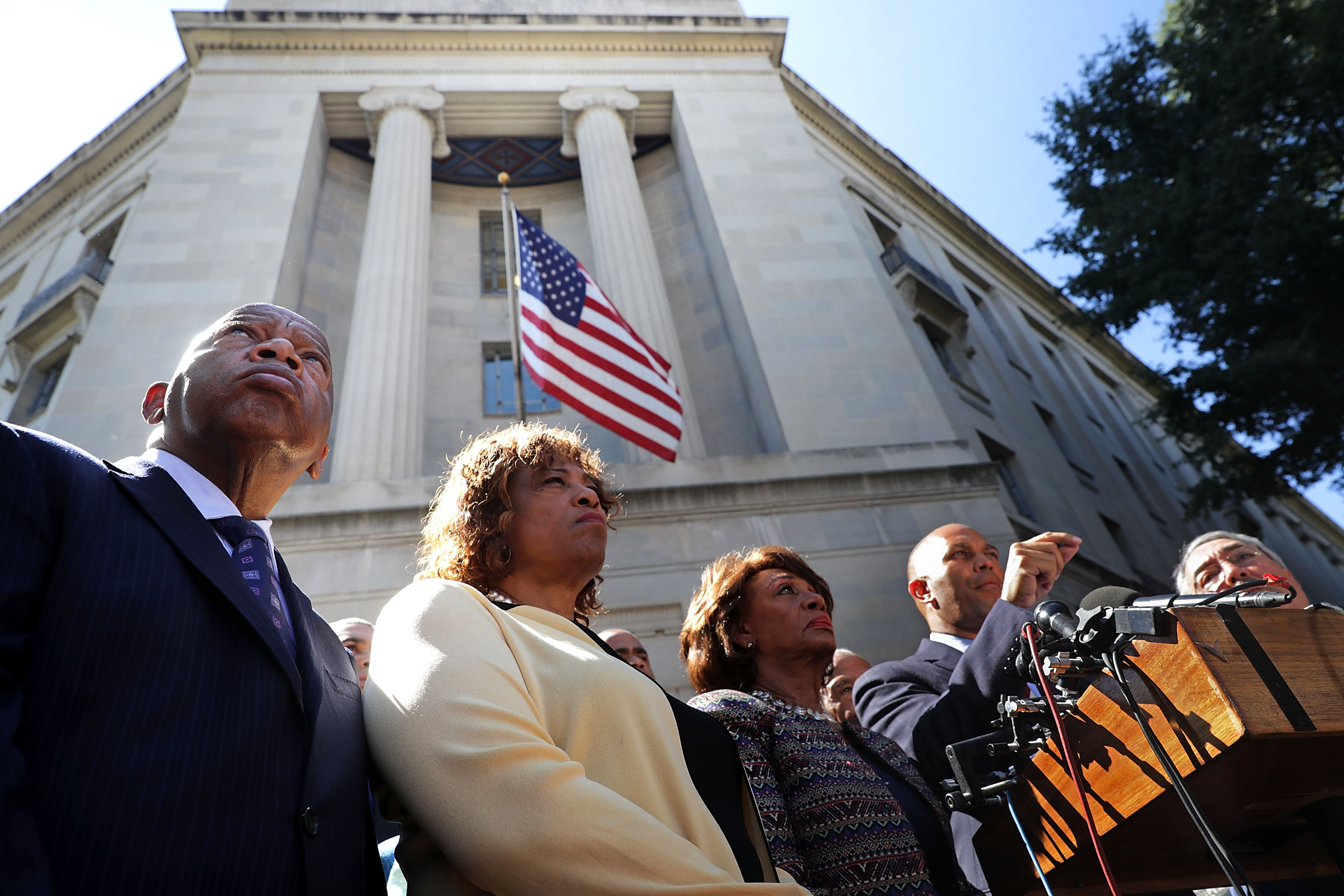 """WASHINGTON, DC - SEPTEMBER 22:  (L-R) Civil rights pioneer Rep. John Lewis (D-GA), Rep. Brenda Lawrence (D-MI), Rep. Maxine Waters (D-CA) and other members of the Congressional Black Caucus hold a news conference after marching to the Department of Justice from the U.S. Capitol September 22, 2016 in Washington, DC. The caucus members marched to the Department of Justice to deliver a letter to Attorney General Loretta Lynch """"urging her to use the power of her office to bring about prosecutions for the targeting and profiling of black men, women and children"""" by law enforcement.  (Photo by Chip Somodevilla/Getty Images)"""