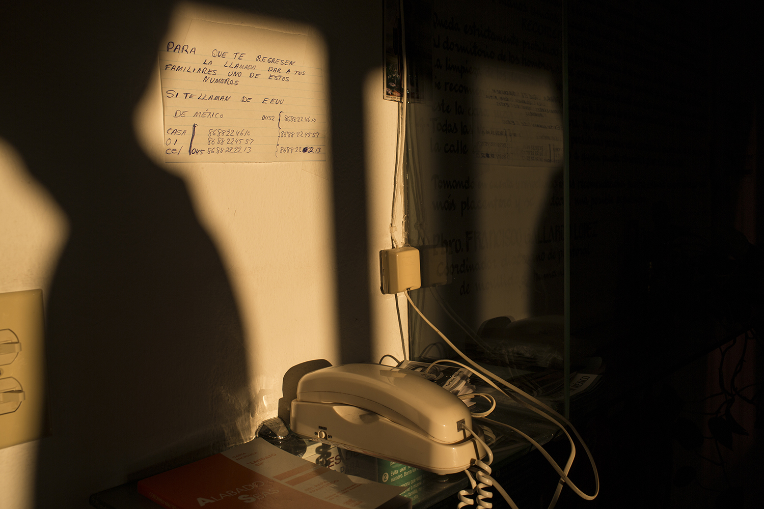 """A phone used by migrants to call their families sits in the """"Casa del Migrante"""" migrant shelter in Matamoros, Tamaulipas state, Mexico, Wednesday, March 22, 2017, across the border from Brownsville, Texas. (AP Photo/Rodrigo Abd)"""