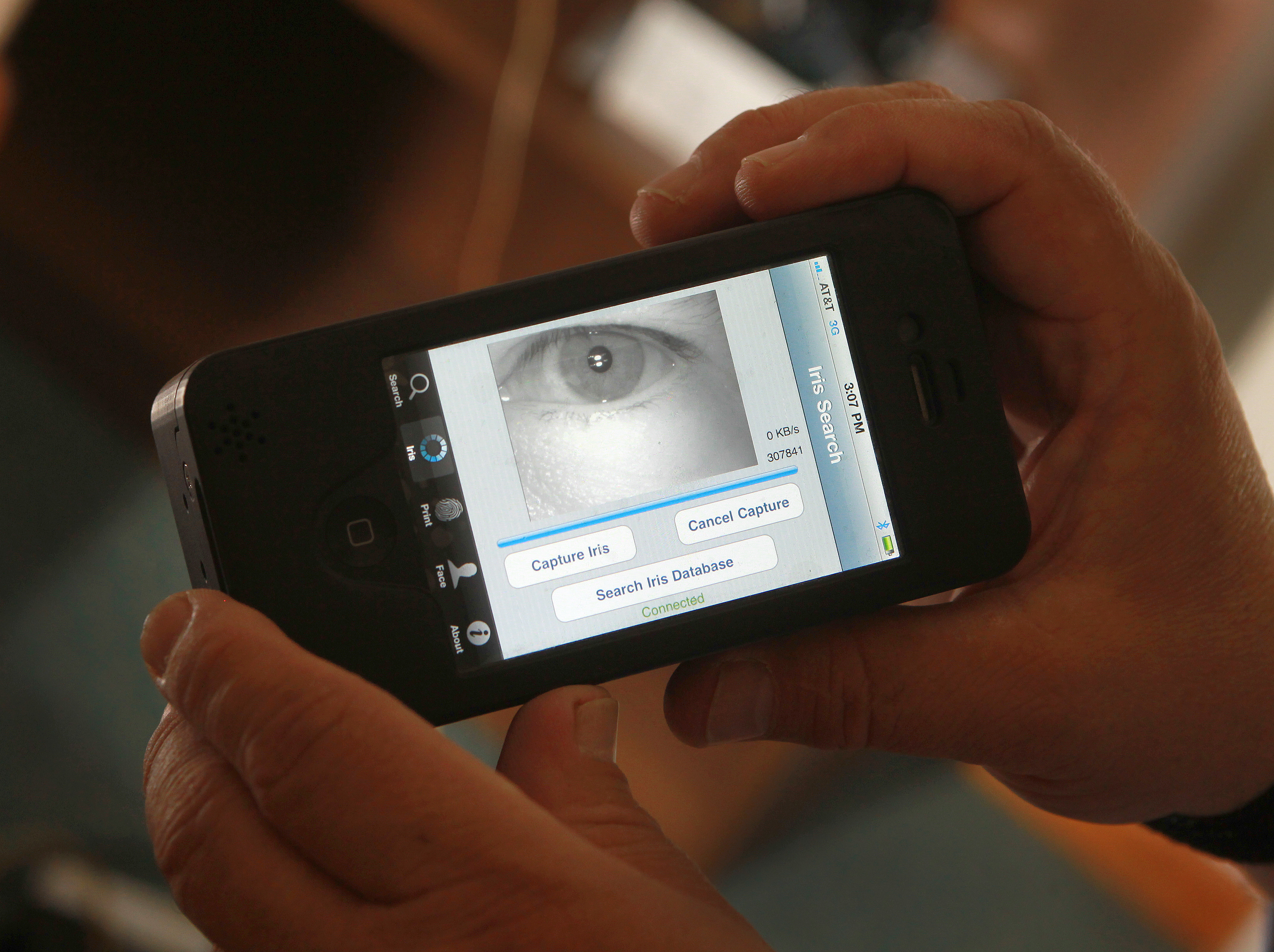 PLYMOUTH - JULY 15: After scanning the iris, an image appears on the Mobile Offender Recognition and Information System (MORIS) for comparison in a central database. The MORIS is a multi-modal biometric identification device on a smart phone that can take a photograph, an iris scan or a fingerprint and compare the results against a central data base. (Photo by Barry Chin/The Boston Globe via Getty Images)