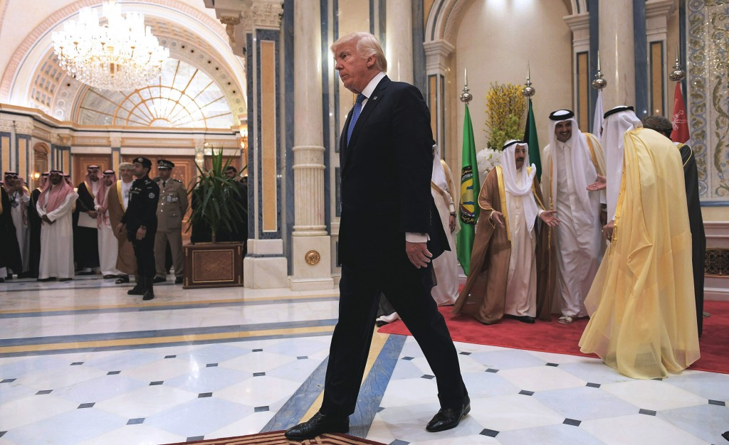 US President Donald Trump (C) walks away after posing for a group picture with leaders of the Gulf Cooperation Council in Riyadh on May 21, 2017. / AFP PHOTO / MANDEL NGAN (Photo credit should read MANDEL NGAN/AFP/Getty Images)