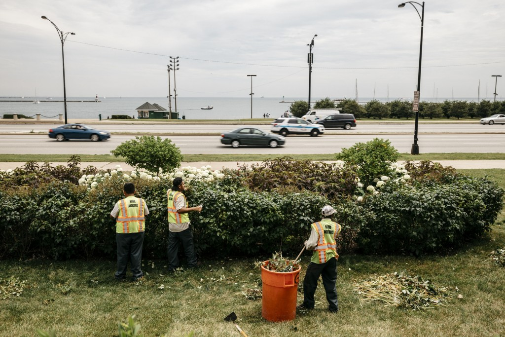 "Chicago, IL - July 13, 2017 - Landscapers work across Lake Shore Drive from ""Queens Landing"", the location where Jedediah Brown parked his car near the shore of Lake Michigan and the incident with the Chicago Police Department's SWAT team ensued."