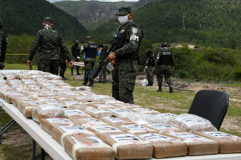 Authorities incinerate a load of cocaine seized to two Colombian nationals navigating along the Caribbean, in Tegucigalpa, on July 11, 2017. / AFP PHOTO / ORLANDO SIERRA        (Photo credit should read ORLANDO SIERRA/AFP/Getty Images)
