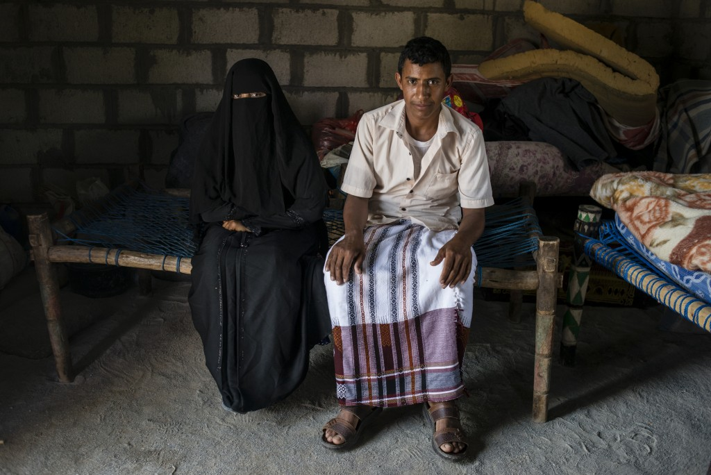 Yahya Ja'afar, 20, sits with his wife Fatum Alam, 20, on May 6, 2018 in al Ragha Village, Bani Qais District, Hajjah, Yemen. Their wedding celebration turned into a nightmare when an airstrike hit the mens side of the celebrations. They only officially moved in together and married two weeks after the destroyed wedding.