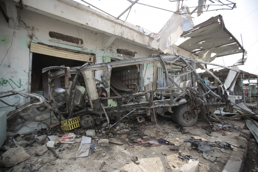 The wreckage of a bus remains at the site of a deadly Saudi-led coalition airstrike on Thursday, in Saada, Yemen, Sunday, Aug. 12, 2018. Yemen's shiite rebels are backing a United Nations' call for an investigation into the airstrike in the country's north that hit a bus carrying civilians, many of them school children in a busy market, killing dozens of people including many children. (AP Photo/Hani Mohammed)