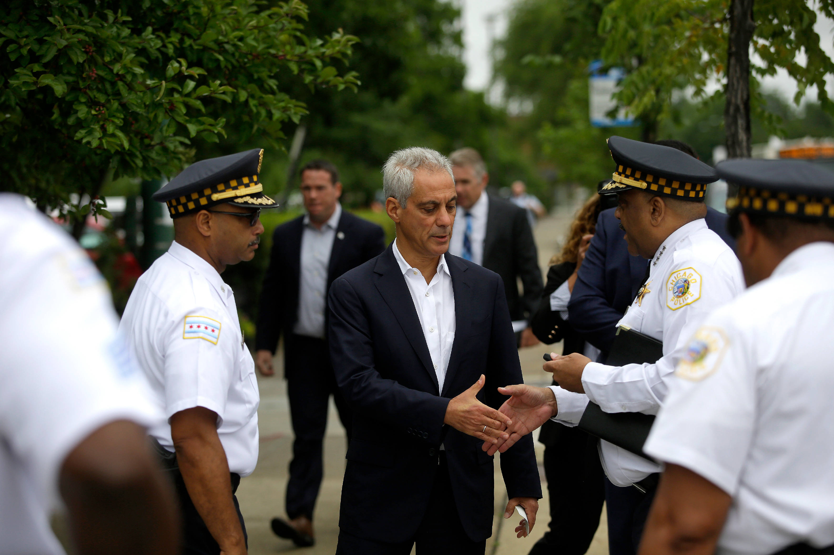 Chicago Mayor Rahm Emanuel greets Chicago Police Superintendent Eddie Johnson before they spoke at a news conference to address reporters about Chicago's weekend of gun violence, Monday, August 6, 2018 in Chicago, Illinois. Chicago experienced one of it's most violent weekends of the year, after more then 70 people were shot, with 12 fatalities. (Photo by Joshua Lott/Getty Images)