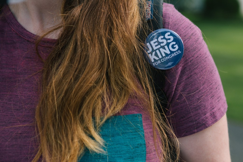 A campaign button for Congressional candidate Jess King is seen on canvassing volunteer Liz Hollcraft in Mount Joy, Pennsylvania on Saturday, August 18, 2018. King, who lives in nearby Lancaster, is running for Congress in Pennsylvania's 11th District.(Michelle Gustafson for The Intercept)