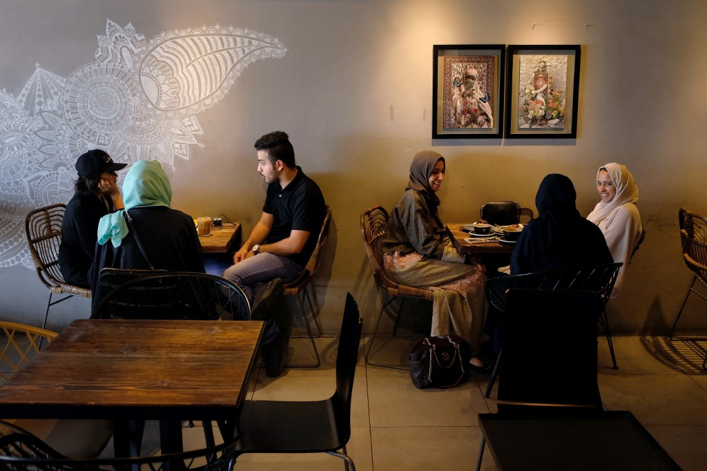 JEDDAH, SAUDI ARABIA - JUNE 21: Guests chat at Medd Cafe and Roastery, a popular hangout where young Saudi men and women mix together freely, on June 21, 2018 in Jeddah, Saudi Arabia. The Saudi government, under Crown Prince Mohammad Bin Salman, is phasing in an ongoing series of reforms to both diversify the Saudi economy and to liberalize its society. The reforms also seek to empower women by restoring them basic legal rights, allowing them increasing independence and encouraging their participation in the workforce. Saudi Arabia is among the most conservative countries in the world and women have traditionally had much fewer rights than men. (Photo by Sean Gallup/Getty Images)