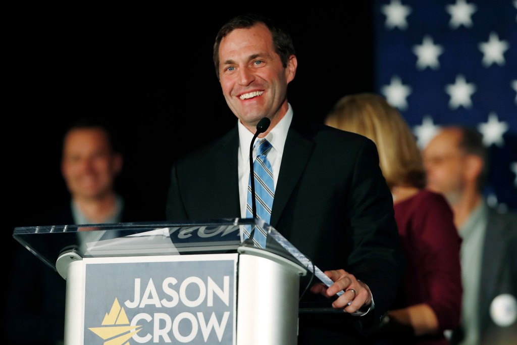 Jason Crow, Democratic candidate for U.S. House seat in Colorado's Sixth Congressional District, Tuesday, Nov. 6, 2018, greets supporters during an election night watch party in Greenwood Village, Colo. Crow defeated Republican incumbent Mike Coffman to win the seat. (AP Photo/David Zalubowski)