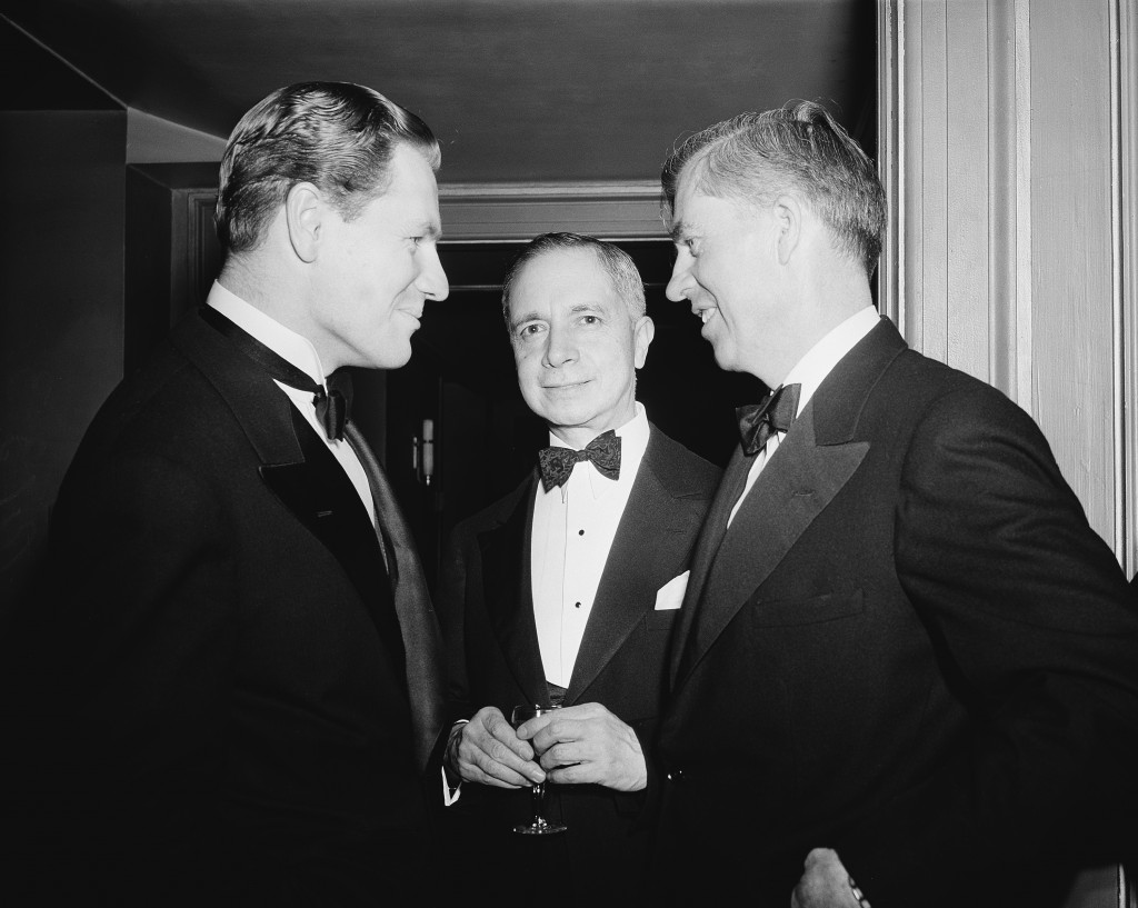 Nelson Rockefeller, left, coordinator of commercial and cultural relations among the American republics, chats with Senor Dr. Don Adrian Recinos, center, minister from Guatemala to the United States and Vice President Henry Wallace, right, at the National Press Club dinner party for Latin-American diplomats and leaders in Washington, D.C., April 19, 1941. (AP Photo)