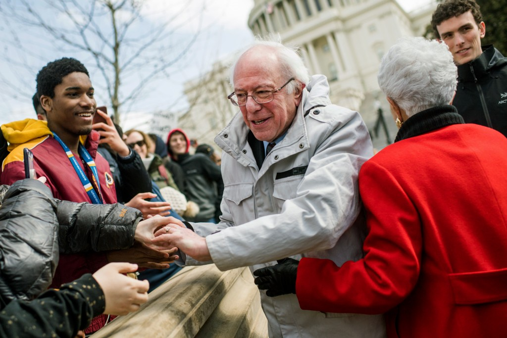 UNITED STATES - MARCH 14: Sen. Bernie Sanders, I-Vt., and Rep. Grace Napolitano, D-Calif., greet students while attending a rally on the West Front of the Capitol to call on Congress to act on gun violence prevention during a national walkout by students on March 14, 2018. (Photo By Tom Williams/CQ Roll Call) (CQ Roll Call via AP Images)