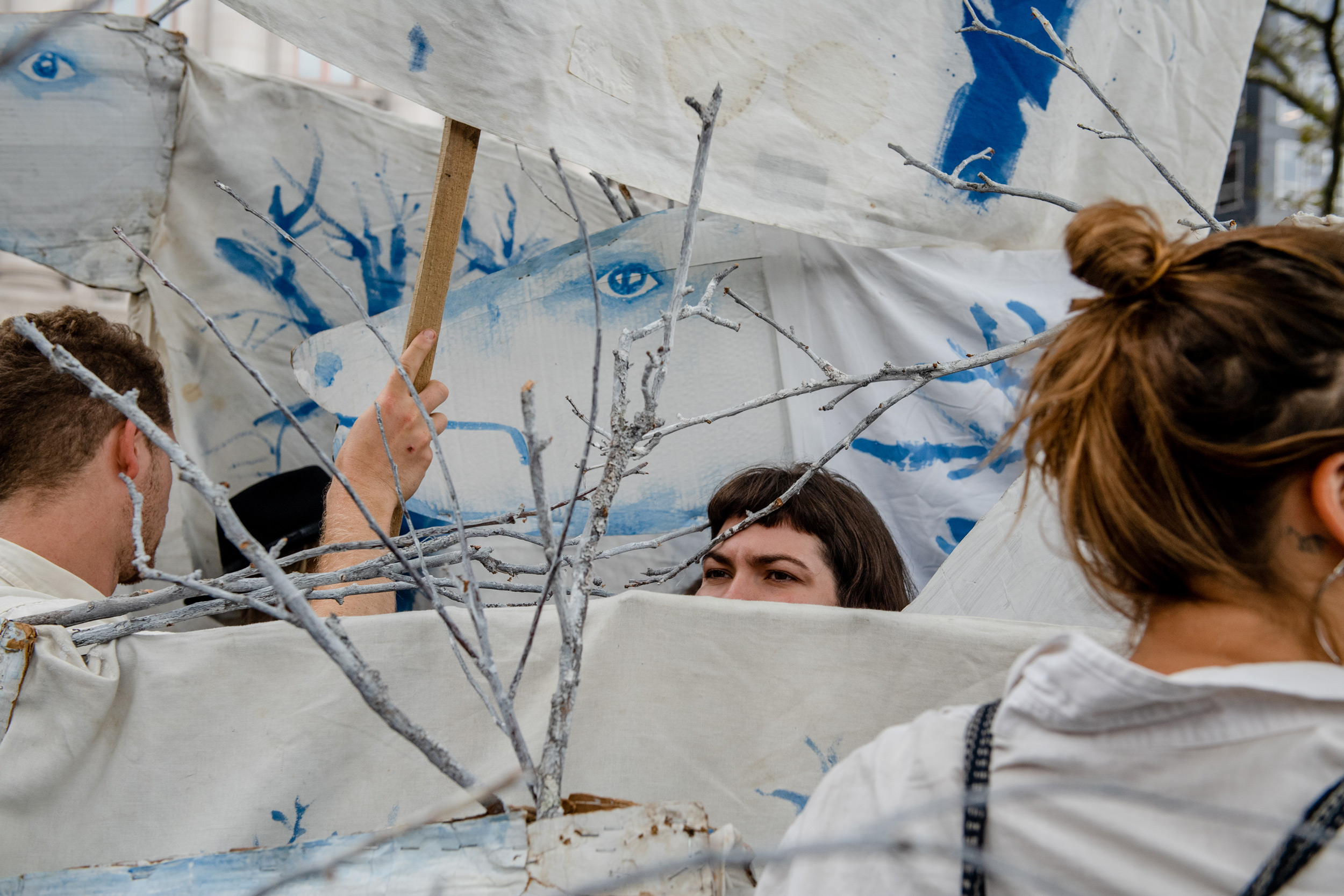 "NEW YORK, NEW YORK– OCTOBER 7, 2019: Performers with Bread and Puppet Theater wait in Battery Park before the environmental group Extinction Rebellion (commonly referred to as XR). On monday they lead a group of protesters in marching and action in Manhattan. Numerous members were arrested while blocking roads and performing ""die-ins."""