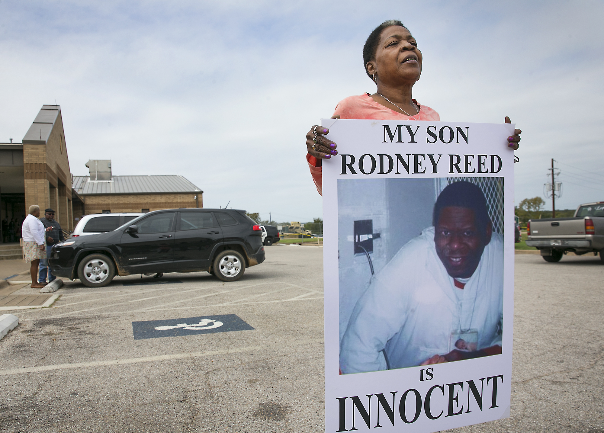 Sandra Reed, the mother of death row inmate Rodney Reed, shows her continued support of her son by carrying this placard around the parking lot during a break in a hearing in Bastrop County District Court on Tuesday, October 10. 2017. Reed was asking Judge Doug Shaver to reconsider testimony from his murder trial in the slaying of Stacey Stites. (Ralph Barrera/Austin American-Statesman via AP)