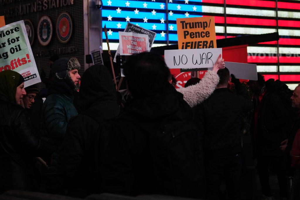 """People participate in a protest in Times Square against military conflict with Iran on January 08, 2020 in New York City, United States. The """"No War With Iran"""" protest follows the assassination of Iranian general Qasem Soleimani by the Trump administration. Around the country groups are speaking out against further military actions between the two adversaries. Yesterday Iran launched a series of missiles at Iraqi bases housing U.S. troops.  (Photo by Spencer Platt/Getty Images)"""