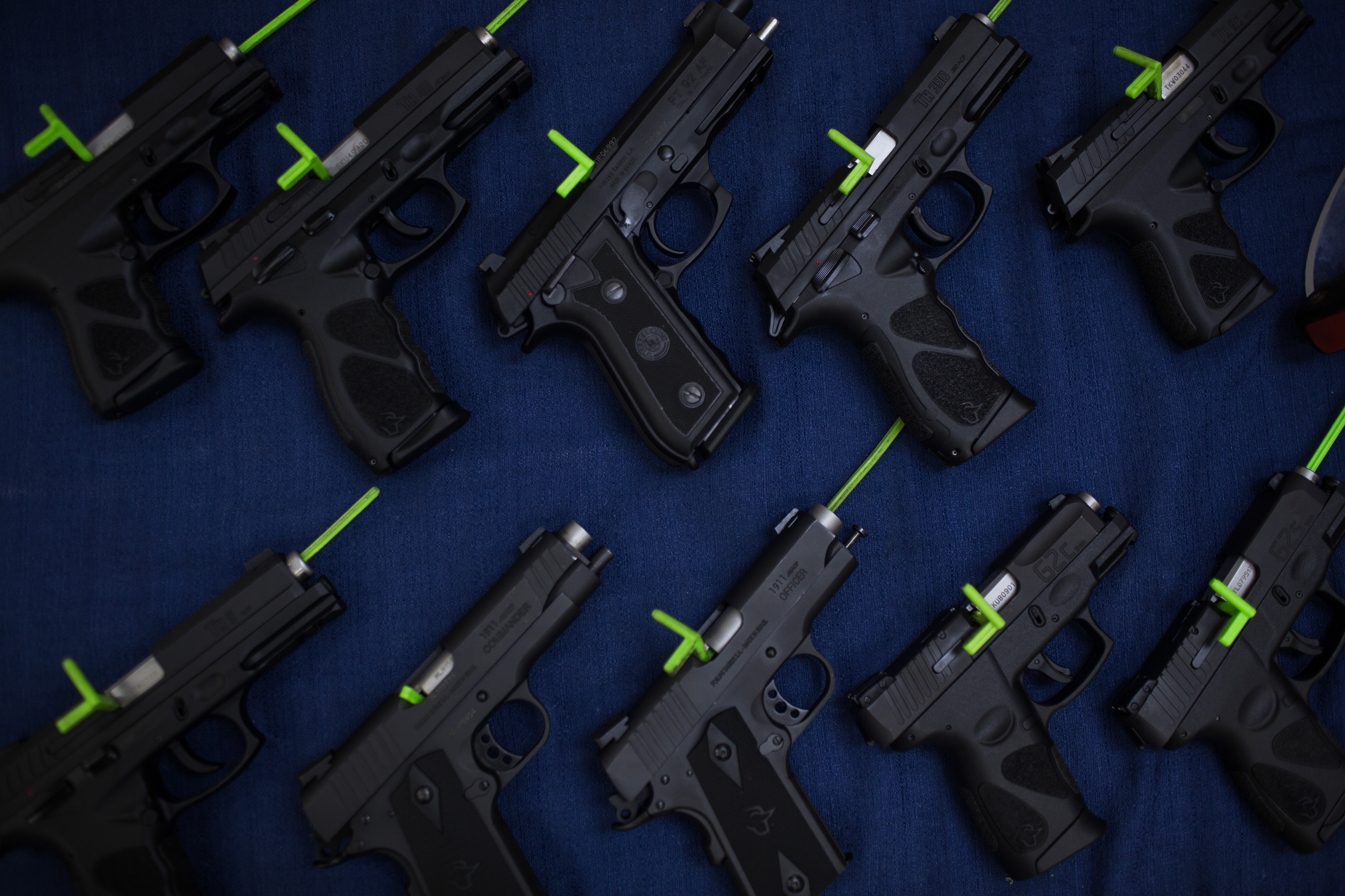 Handguns sit at the Forjas Taurus SA manufacturing facility in Sao Leopoldo, Brazil, on Tuesday, Feb. 5, 2019. Last month, Brazil's President Jair Bolsonaro signed a decree loosening the country's restrictive gun regulations, and hinted at further measures to arm law-abiding citizens to combat rampant crime. Photographer: Victor Moriyama/Bloomberg via Getty Images