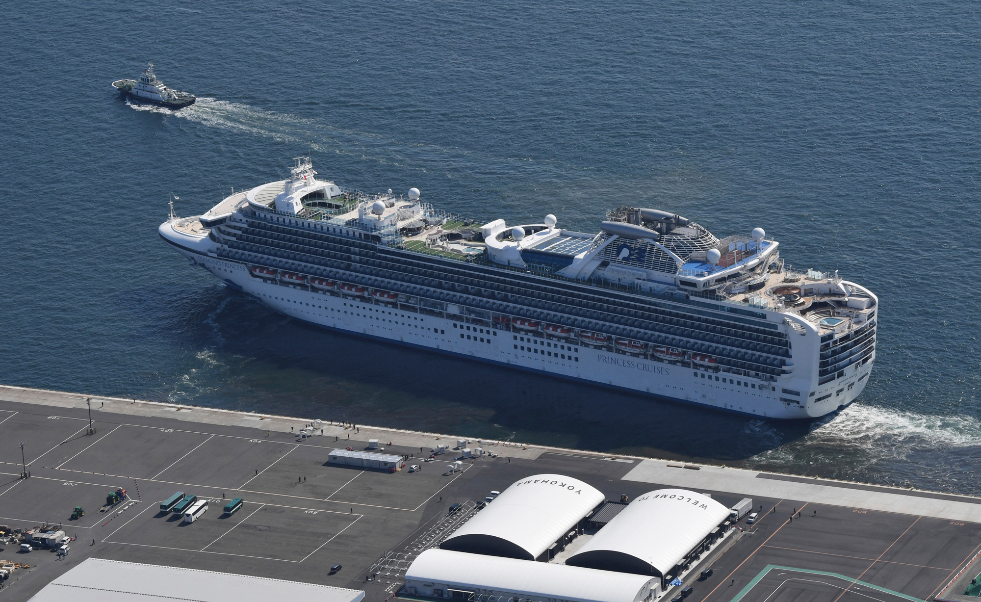A cruise ship Diamond Princess leaves Daikoku Futo Wharf in Yokohama, Kanagawa Prefecture after being disinfected on March 25, 2020, amid the outbreak of a new coronavirus. The virus-hit cruise ship accounted for 712 people who have been infected with the disease and 10 died. ( The Yomiuri Shimbun via AP Images )