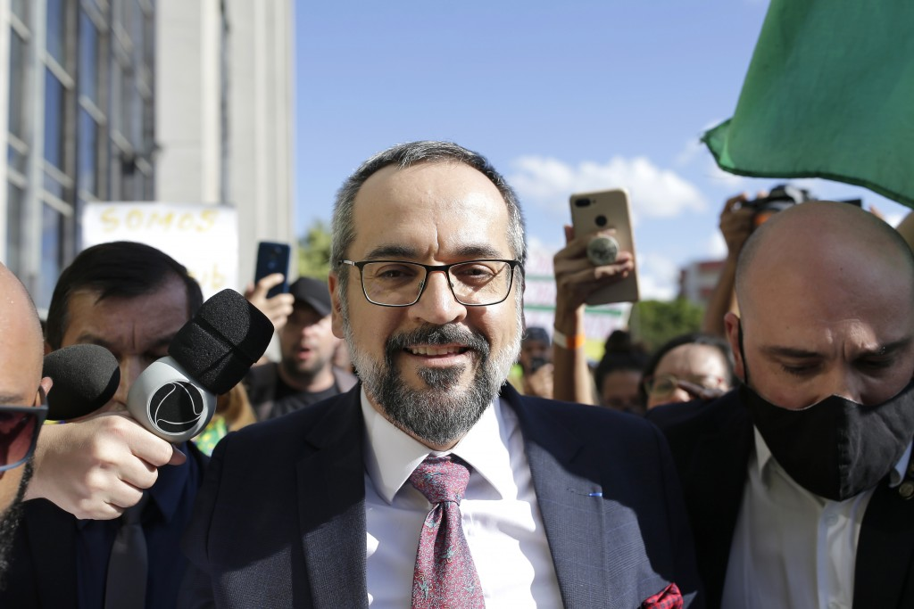 Brazil's Minister of Education, Abraham Weintraub, leaves the Federal Police headquarters building after testifying in an investigation which he answers for alleged crime of racism, in Brasilia, on June 04, 2020. On his way out, the minister was carried in his arms by supporters waiting for him in front of the venue and gave a brief speech on freedom of expression. The inquiry was opened in last April, after the minister posted a message on Twitter in which he makes fun on the accent of some Chinese when they speaking Portuguese. Photo: DIDA SAMPAIO/ESTADAO CONTEUDO (Agencia Estado via AP Images)