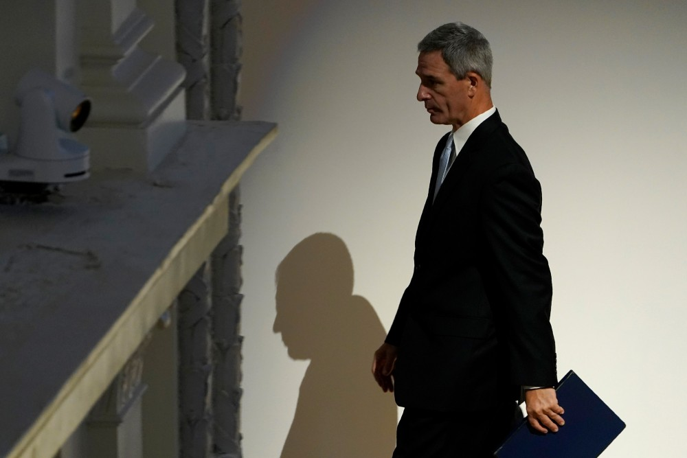 Ken Cuccinelli walks off of the stage after speaking at an event at DHS headquarters in Washington.