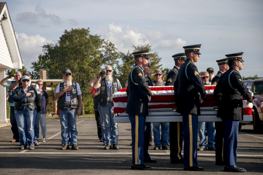 Patriot Guard Riders salute as military members carry the casket of Army Private Gregory Wedel-Morales at Green Hill Cemetery in Sapulpa on July 23, 2020.