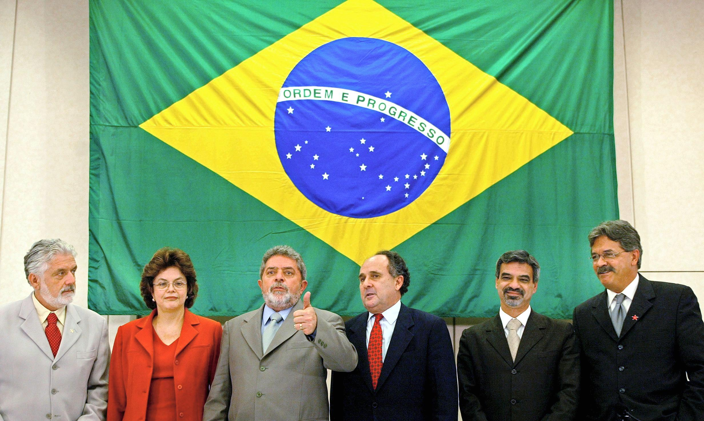 Luiz Inacio Lula da Silva (3rd L), president-elect of Brazil, gives the thumbs-up 20 December, 2002 in Sao Paulo, Brazil, as he presents his ministers (from L-R): Minister of work Jacques Wagner, Energy minister Dilma Rousseff, Education minister Cristovao Buarque, Health minister Humberto Costa and national secretary of Human Rights Nilmario Miranda. AFP PHOTO/Mauricio LIMA (Photo credit should read MAURICIO LIMA/AFP via Getty Images)
