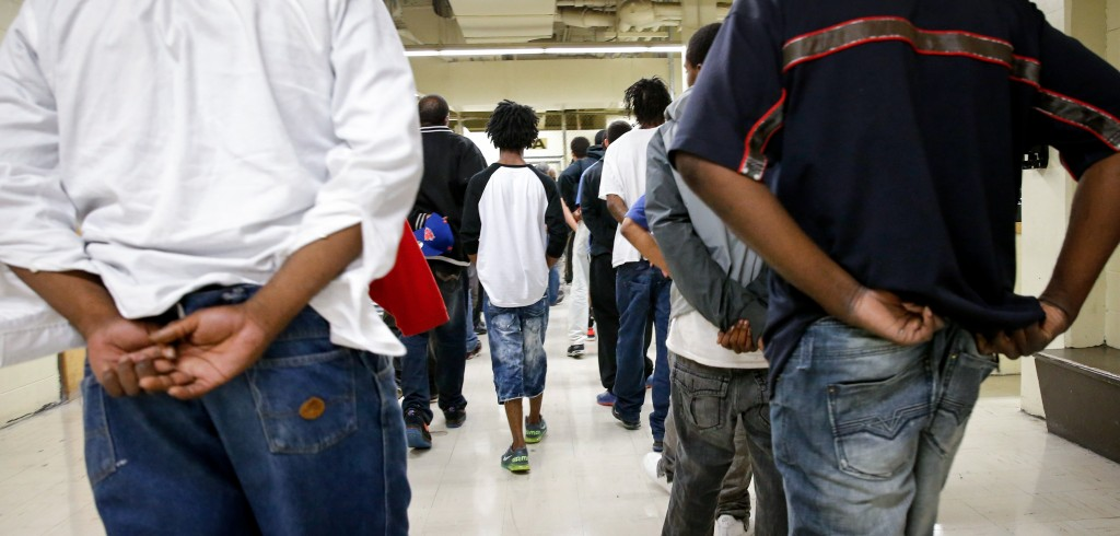 FILE - In this June 26, 2014, file photo inmates at the Cook County jail head off to bond court after their arrested the night before in Chicago. A federal judge has ordered Cook County Jail to take steps to protect inmates from coronavirus. (AP Photo/Charles Rex Arbogast File)
