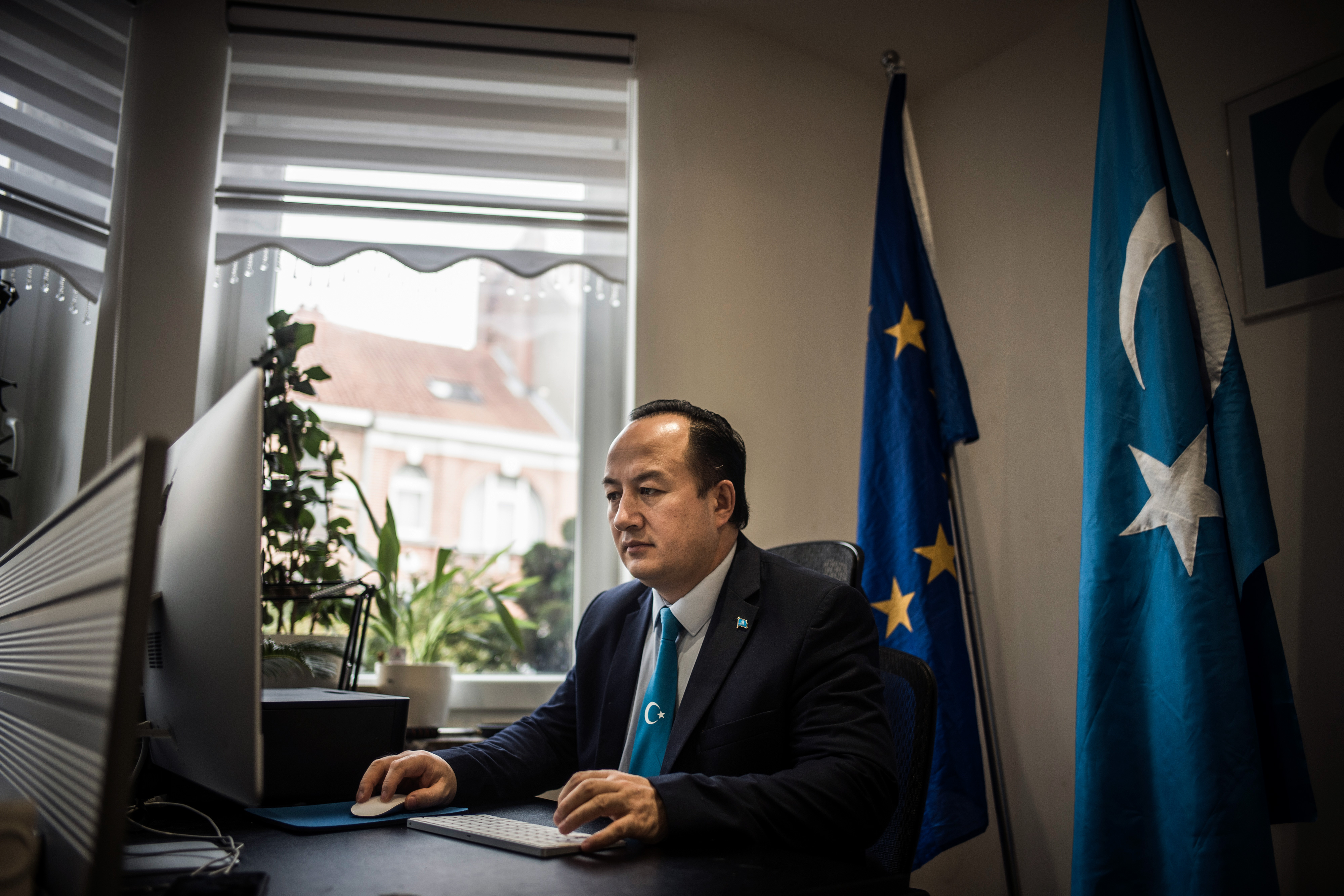 Nejmiddin Qarluq, an ethnic Uyghur, and political activist who fled china and was given asylum in Belgium is pictured at his new home in Bruxelles on Jan. 21, 2021.