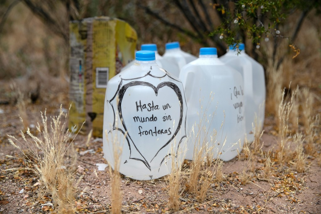 AJO, ARIZONA - MAY 10: Jugs of water for undocumented immigrants sits along migrant trails after being delivered by volunteers for the humanitarian aid group No More Deaths on May 10, 2019 near Ajo, Arizona. The volunteers distributed the aid along trails in remote areas immigrants pass after crossing the border from Mexico. The number of immigrant deaths, mostly due to dehydration and exposure, has risen as higher border security in urban border areas has pushed immigrant crossing routes into more remote desert regions. No More Deaths volunteer Scott Warren is scheduled to appear in federal court on May 29 in Tucson, charged by the U.S. government on two counts of harboring and one count of conspiracy for aiding two Central American immigrants in January, 2018. If found guilty Warren could face up to 20 years in prison. The trial is seen as a watershed case by the Trump Administration, as it pressures humanitarian organizations working to reduce suffering and deaths of immigrants in remote areas along the border. The government claims the aid encourages human smuggling. In a separate misdemeanor case, federal prosecutors have charged Warren with abandonment of property, for distributing food and water along migrant trails. (Photo by John Moore/Getty Images)