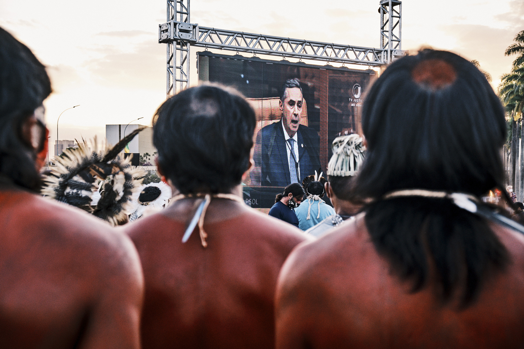 A screen shows Supreme Court Justice LuisRobertoBarroso during a protest against a land demarcation judgment outside the Supreme Court building in Brasilia, Brazil, on Wednesday, Aug. 25, 2021. Indigenous protesters have gathered in Brasilia this week to protest a Supreme Court judgment on Wednesday that could take away ancestral lands. Photographer: Gustavo Minas/Bloomberg via Getty Images
