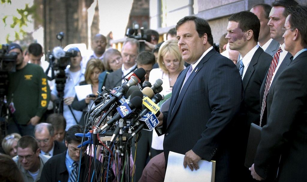 """UNITED STATES - MAY 08: U.S. Attorney Christopher Christie, speaking at podium, holds a news conference on the steps of the Federal Courthouse in Camden, New Jersey, Tuesday, May, 8, 2007. U.S. authorities charged six men, including five identified as """"radical Islamists,"""" in a plot to kill American soldiers at the Fort Dix Army base in New Jersey. (Photo by Bradley C. Bower/Bloomberg via Getty Images)"""
